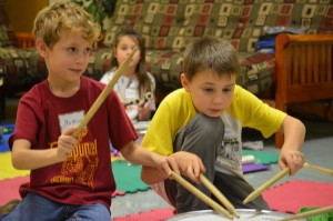Students learn the fundamentals of playing the drums