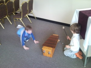 Young Children playing xylophone High and Low music play